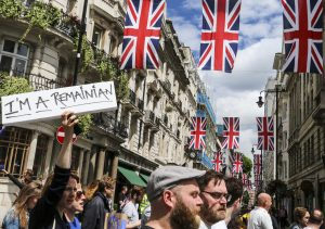 London, UK - July 2, 2016: A group of people protesting the result of the EU Referendum in the UK on on 23 June, which saw the UK vote for Brexit - a withdrawal from the EU. The 'Remainian' is a play on words, referring to Romanians who had been permitted into the UK because of EU laws but who now may be sent back.